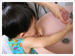 Abigail washing her hands